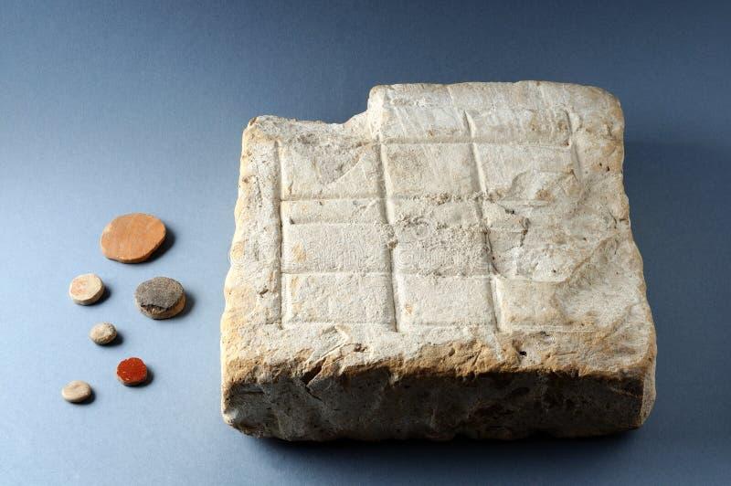 Placa romana do jogo fotografia de stock