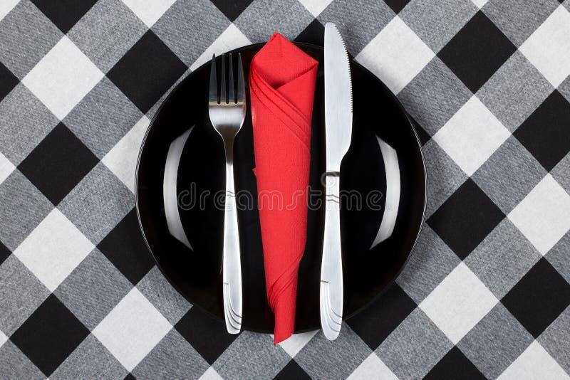 Placa, tenedor y cuchillo foto de archivo libre de regalías