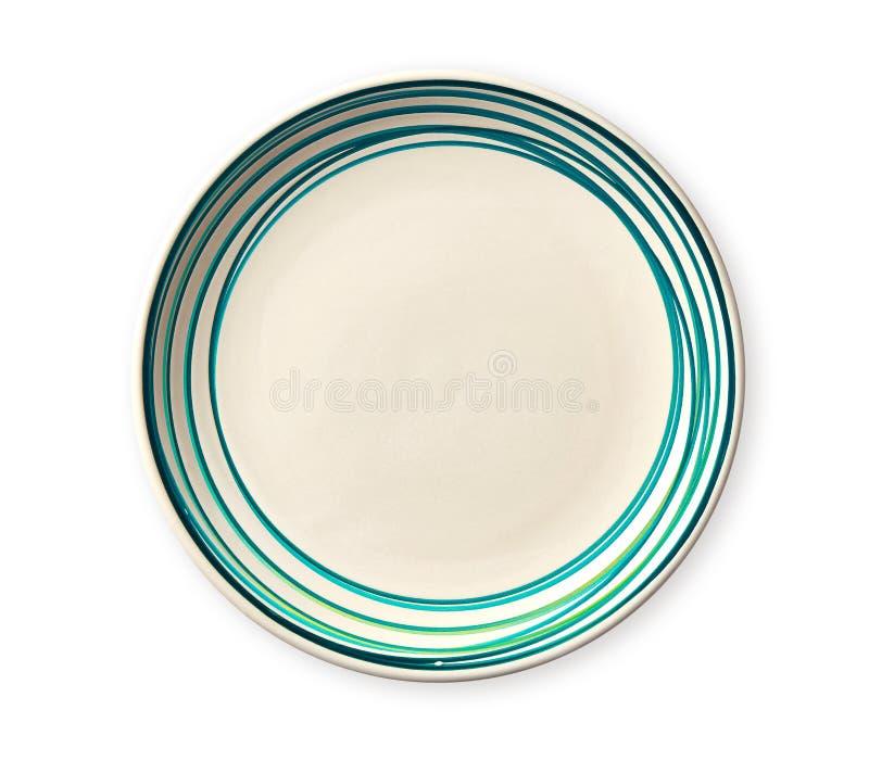 Placa vacía con el borde azul del modelo, placa de cerámica con el modelo espiral en los estilos de la acuarela, aislados en el f imagen de archivo