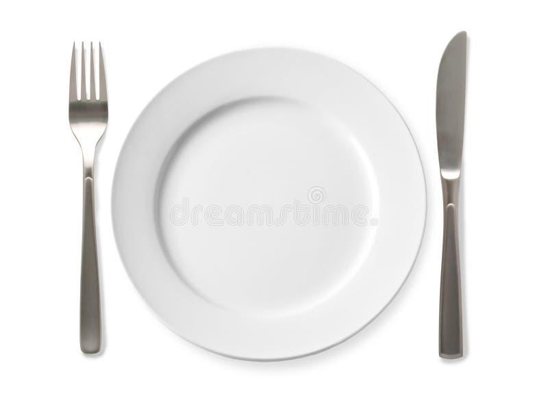 Placa vazia com faca e forquilha em um fundo branco fotografia de stock