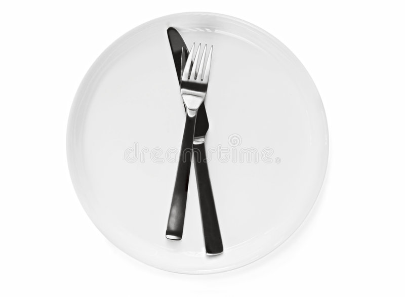 Placa y cuchillería fotografía de archivo