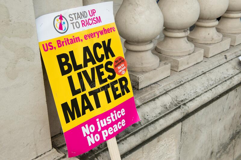 Placard at the UK Black Lives Matter protest march in London. London, UK. 16th July 2016. Placard used by protesters at the Black Lives Matter / Stand Up To stock photography