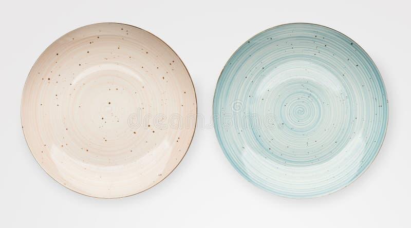Placas de cerámica rosadas vacías aisladas imagenes de archivo