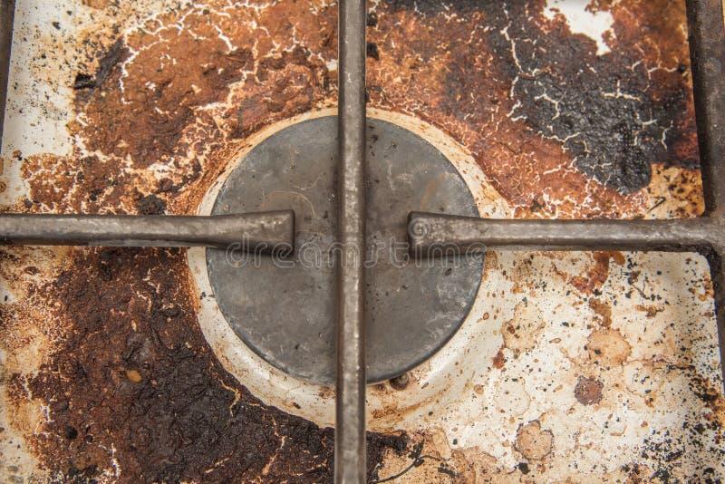 Placas de la cocina de gas manchadas durante cocinar fotos de archivo libres de regalías