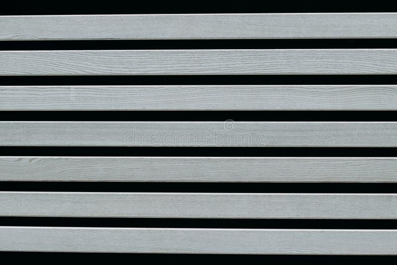 Placas de madeira cinzentas em um fundo preto fotografia de stock royalty free