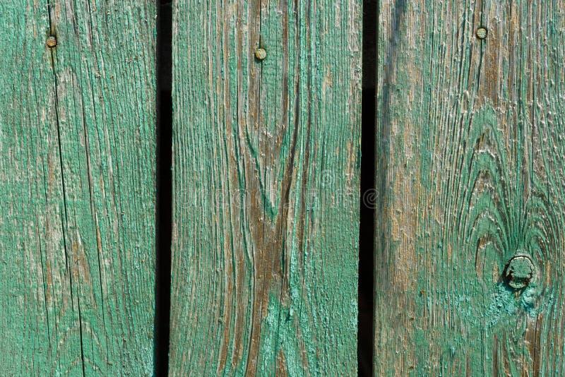 Placas de madeira do vintage com pintura verde rachada, fundo fotografia de stock royalty free