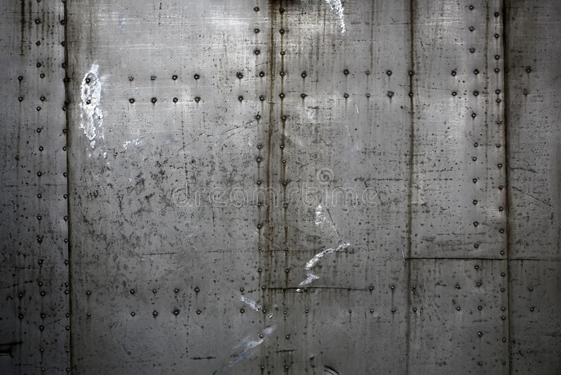 Placas de metal montadas con los remaches fotografía de archivo libre de regalías