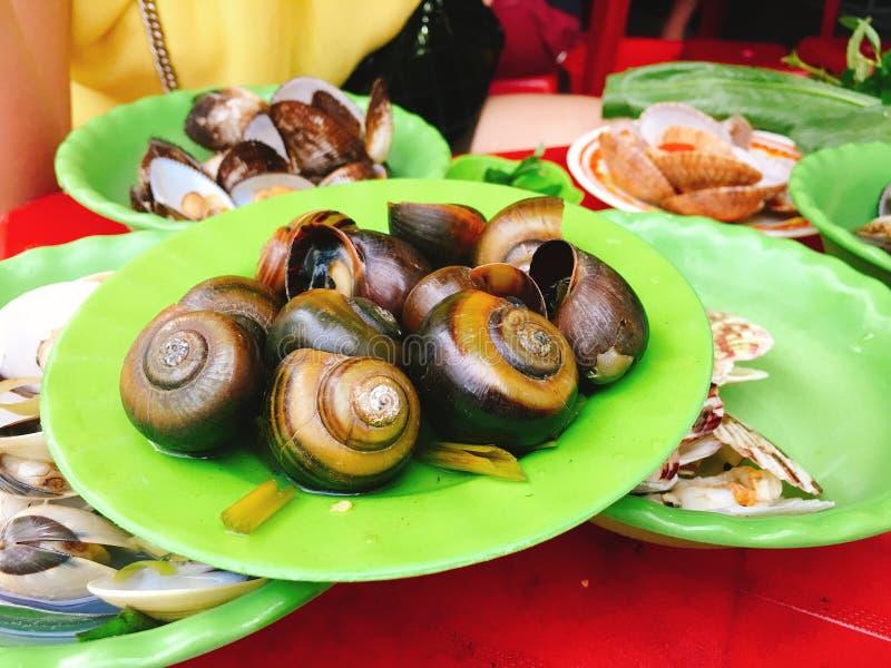 Placas do marisco cozinhado, Vietname fotos de stock