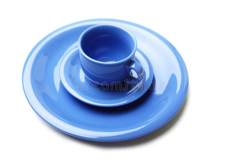 Placas e teacup azuis imagem de stock royalty free
