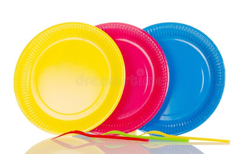 Placas plásticas amarelas, cor-de-rosa, azuis isoladas no branco foto de stock royalty free
