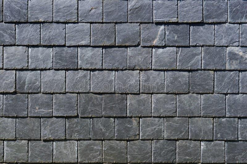 Placas quadradas de uma pedra frágil preta foto de stock