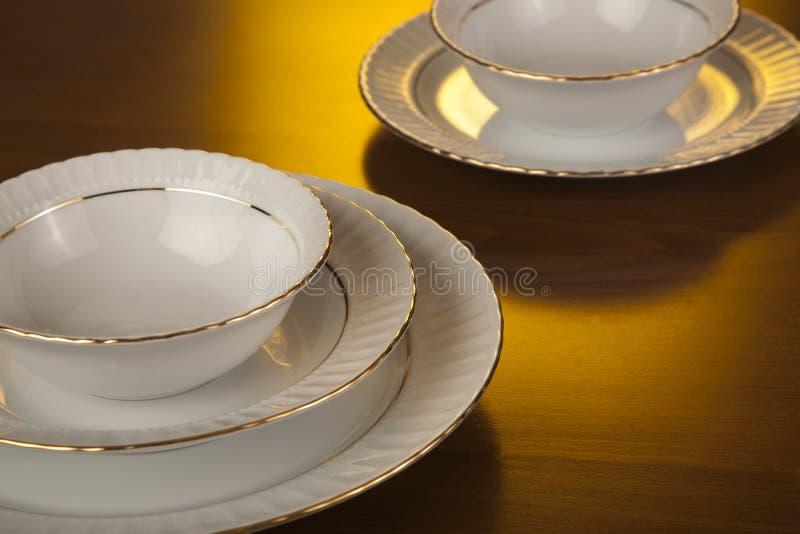 Placas y tazones de fuente de la porcelana fotografía de archivo