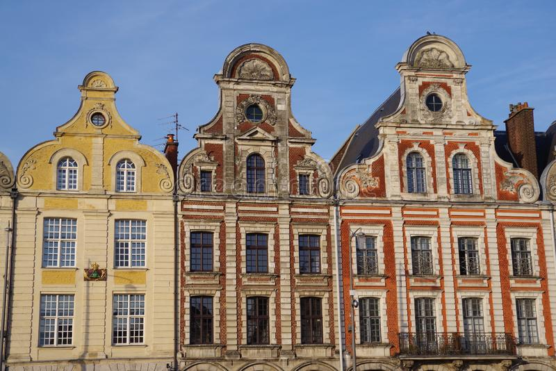 Place of Arras in France with typical houses. Facades of typical Flemish medieval houses in a square of Arras in France royalty free stock photo