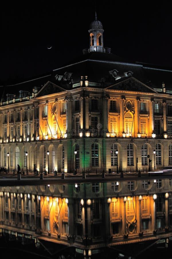 Place de la Bourse, Bordeaux. Place de la Bourse (1745-1747, designed by Jacques-Ange Gabriel) and water mirror at night, Bordeaux, France stock photos