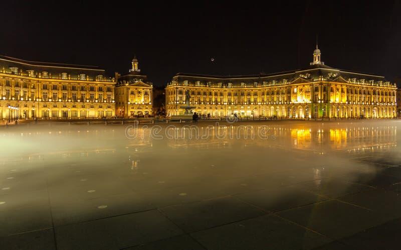 Place de la Bourse at Night, Bordeaux. Place de la Bourse (1745-1747, designed by Jacques-Ange Gabriel) and water mirror at night, Bordeaux, France stock images