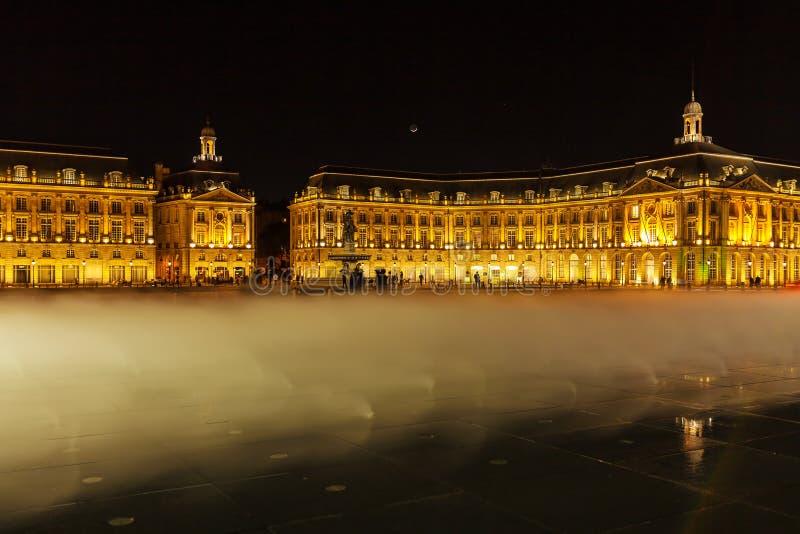 Place de la Bourse at Night, Bordeaux. Place de la Bourse (1745-1747, designed by Jacques-Ange Gabriel) and water mirror at night, Bordeaux, France royalty free stock photo