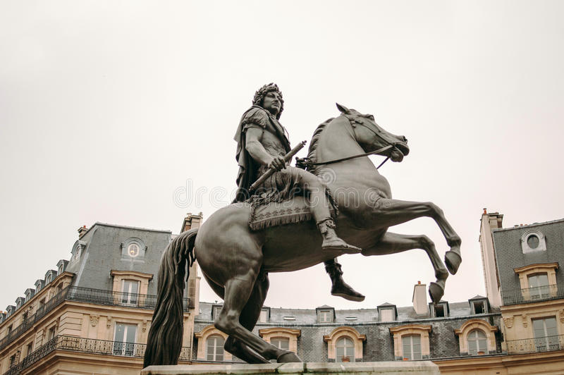 Place des Victoires in Paris with the equestrian monument in hon royalty free stock images
