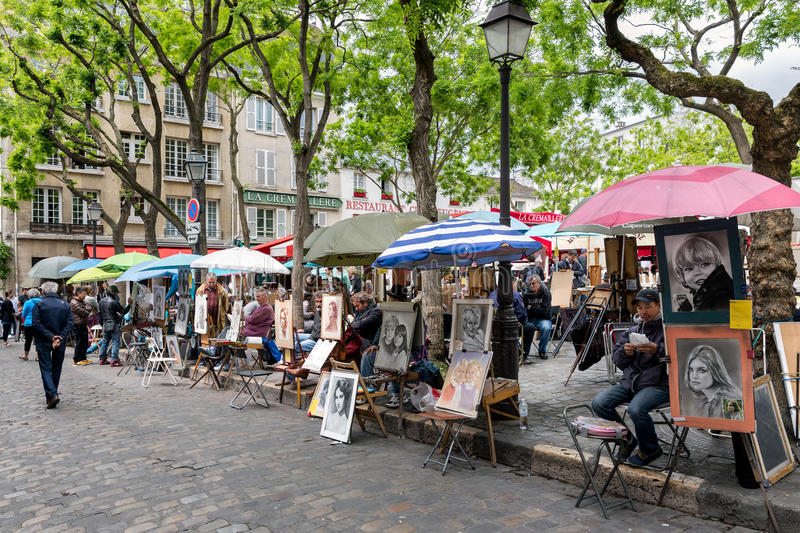 Place du Tertre in Paris with artists ready to paint tourists royalty free stock photos