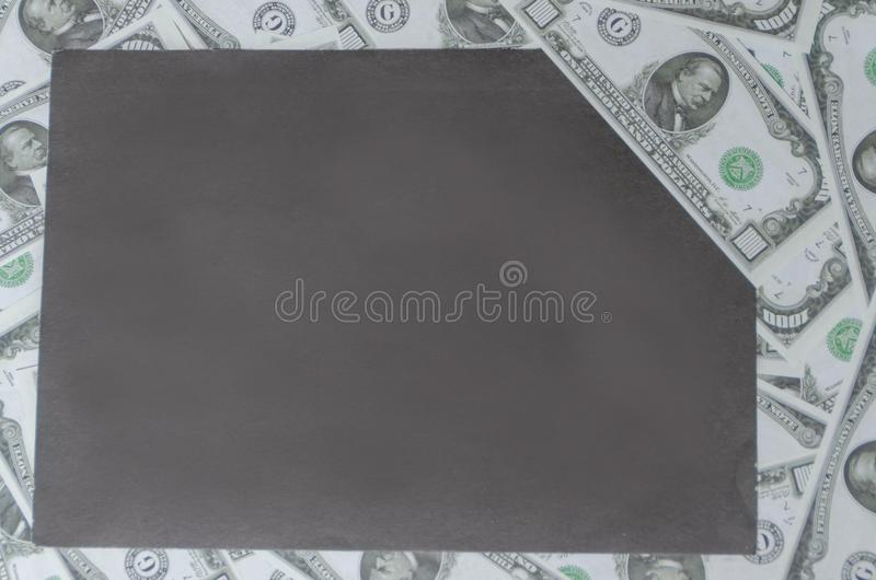 On the background of money on the sheet, place the graphic stock photos