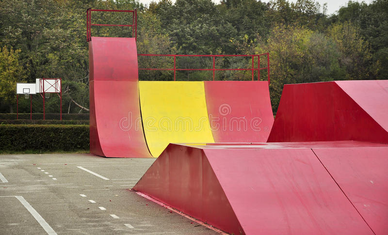 Place for joy skate ground. Found in forest, a place for recreation. Basket ball field and skate ramps stock photography