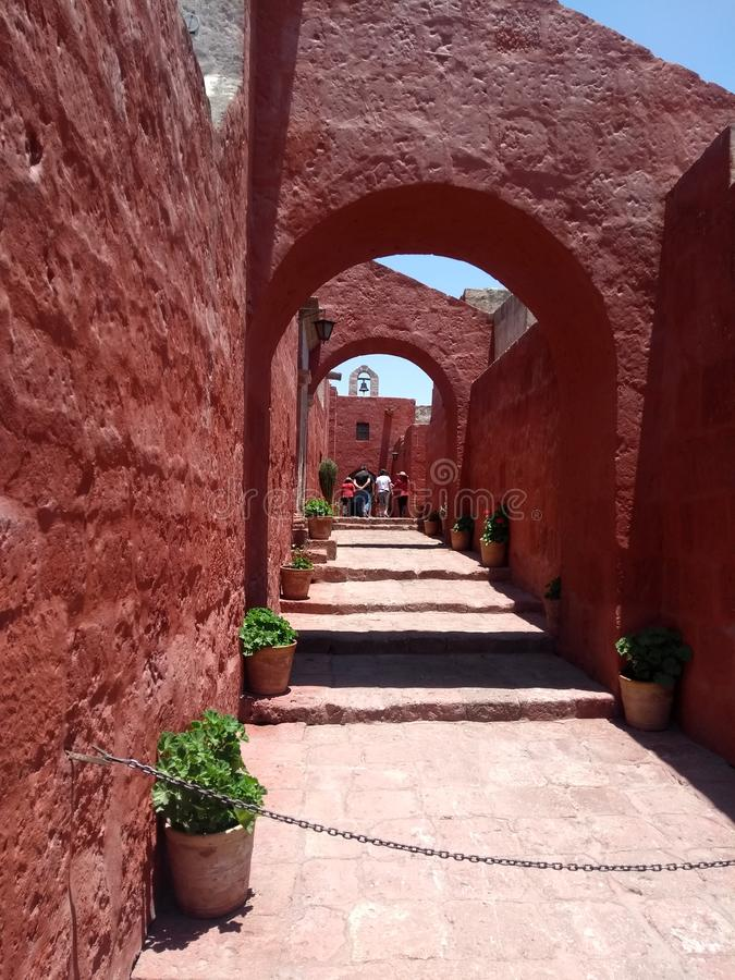 Old red street-Monasterio de Santa Catalina-Arequipa-Perú. This place is part of St. Catherine`s Monastery located in Arequipa City, Peru. The picture shows royalty free stock photography