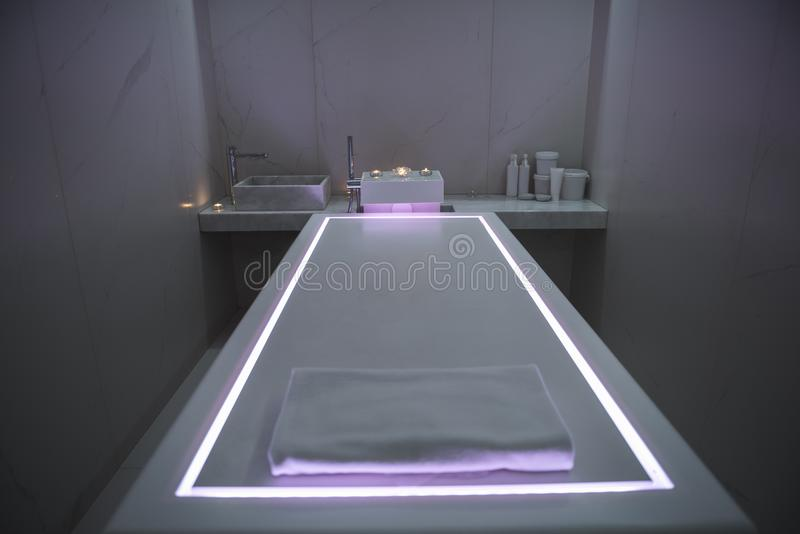 Interior of modern spa massage room with dim light royalty free stock images