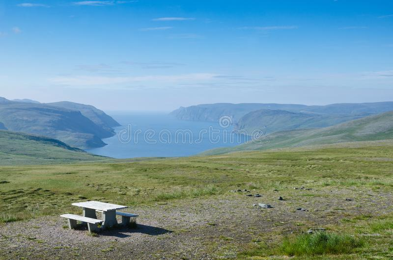 Place for rest in the Norwegian island Mageroya. Table with benches on the hill of the island Mageroya in the extreme northern part of Norway stock image