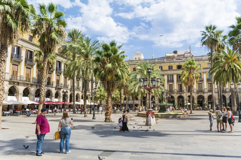 Place Royale in Barcelona,Spain. Barcelona, Spain - August 15, 2017 - fountain and palms in the Place Royale stock image