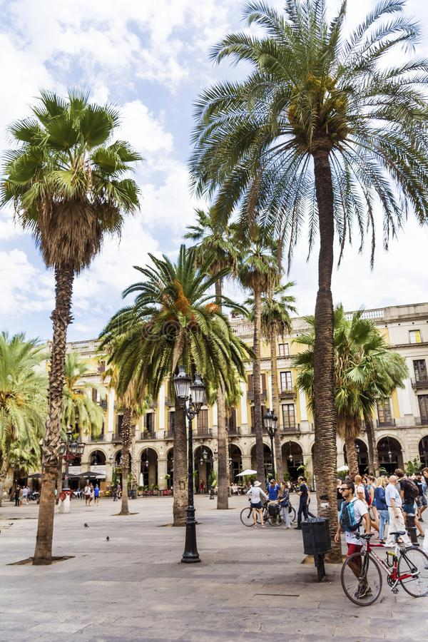 Place Royale in Barcelona,Spain. Barcelona, Spain - August 15, 2017 - fountain and palms in the Place Royale stock images