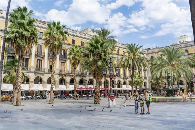Place Royale in Barcelona,Spain. Barcelona, Spain - August 15, 2017 - fountain and palms in the Place Royale square stock image