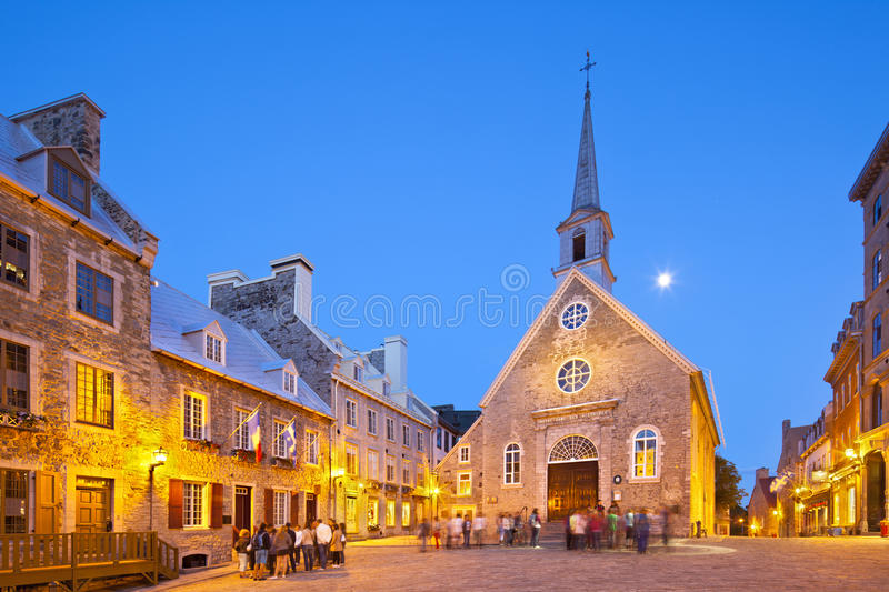 Place Royale in Quebec City, Canada, editorial. Quebec City - June 20: Notre-Dame-des-Victoires at Place Royale in Quebec City, Canada with its old buildings on stock image
