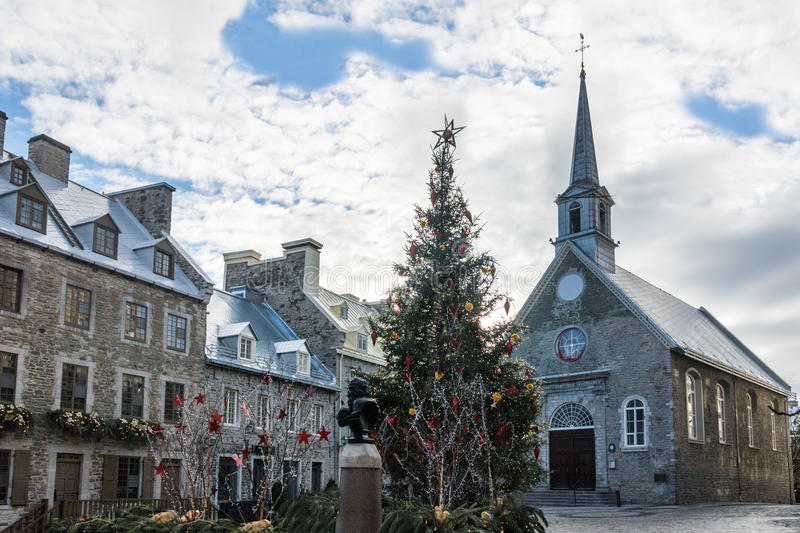 Place Royale Royal Plaza and Notre Dame des Victories Church decorated for Christmas - Quebec City, Canada. Place Royale Royal Plaza and Notre Dame des Victories stock images