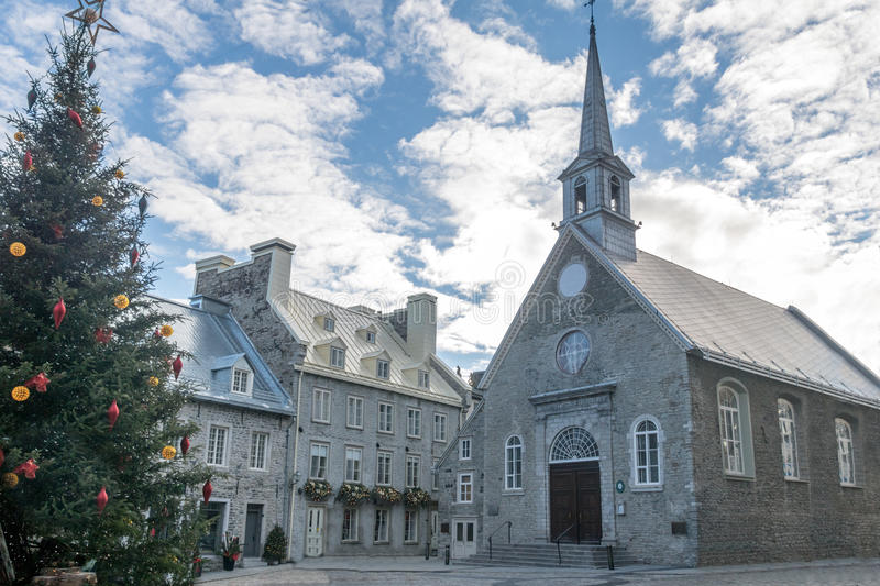 Place Royale Royal Plaza and Notre Dame des Victories Church decorated for Christmas - Quebec City, Canada. Place Royale Royal Plaza and Notre Dame des Victories royalty free stock photography