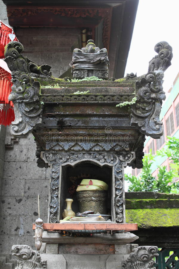 Place of sacrifices by Hinduist temple. Place of sacrifices by Hindu temple in Denpasar - Bali, Indonesia stock photos