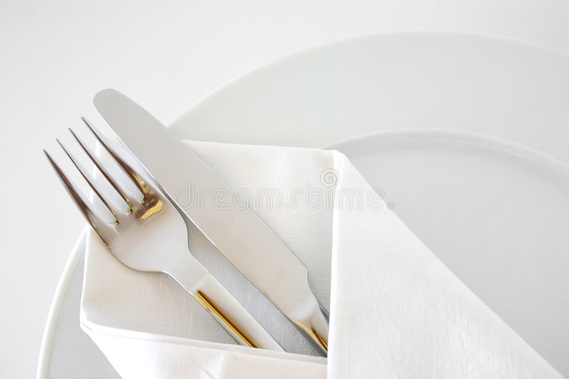 Place setting 3. Silverware on white plates