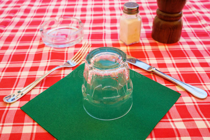 Place setting on a table of an Italian street restaurant stock images