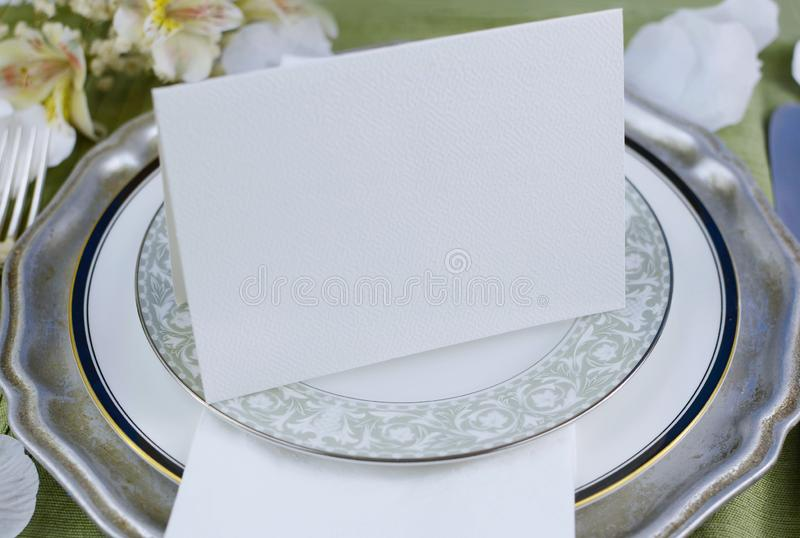 Place setting for wedding reception featuring mixed old and modern patterns. royalty free stock photo