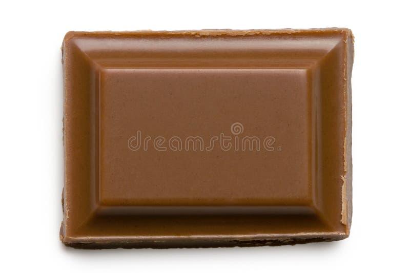 Place simple de chocolat au lait d'isolement sur blanc d'en haut photos stock
