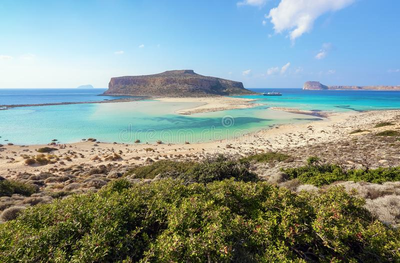 Place for tourists rest Balos lagoon, shore of Crete island, Greece. Ionian, Aegean and Libyan seas. Scenery of sunny summer day. royalty free stock photos
