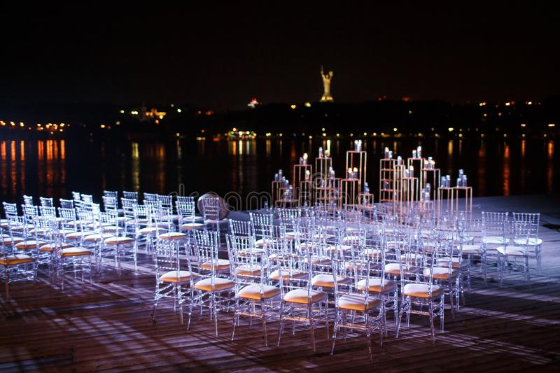 The place of the wedding ceremony at night against the background of the river stock photography