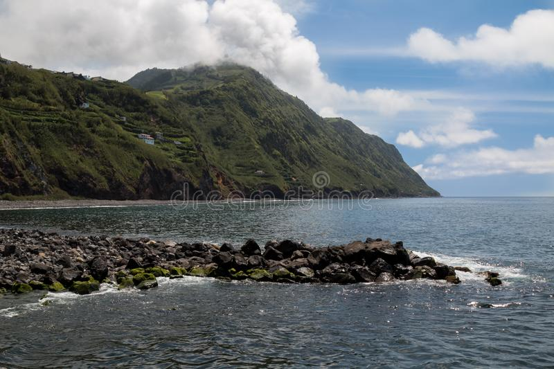 River flowing to the ocean, Povoacao, Sao Miguel royalty free stock photography