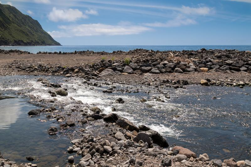River flowing to the ocean, Povoacao, Sao Miguel stock images