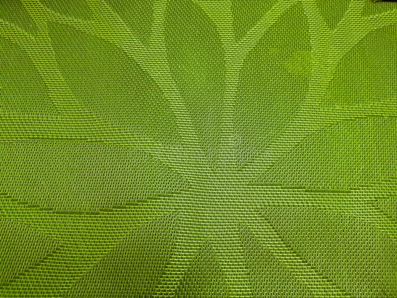 placemat in green with the figure of Eve stock photography
