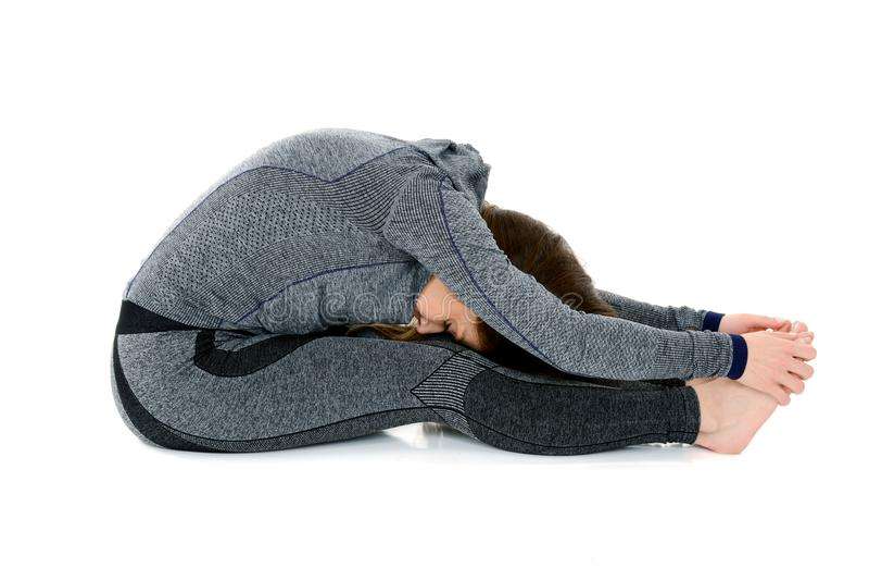 Placerad framåt krökning Paschimottanasana för yoga asana arkivbild