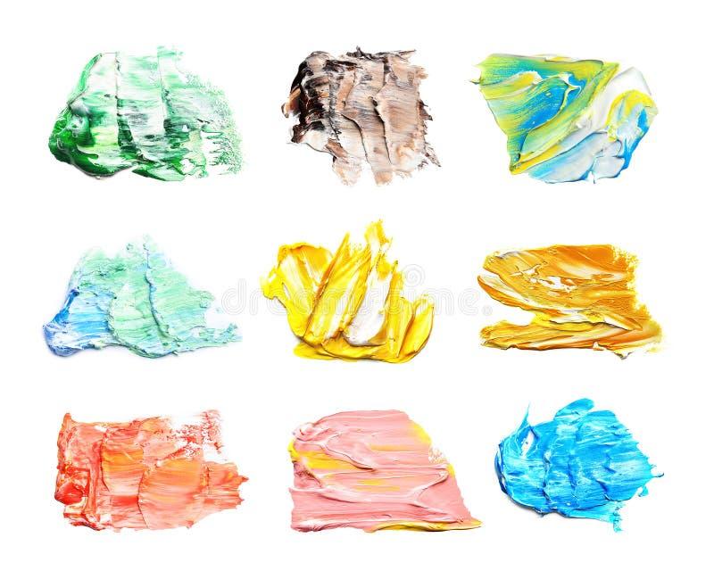 Placez avec des traçages abstraits de différentes peintures sur le fond blanc illustration stock