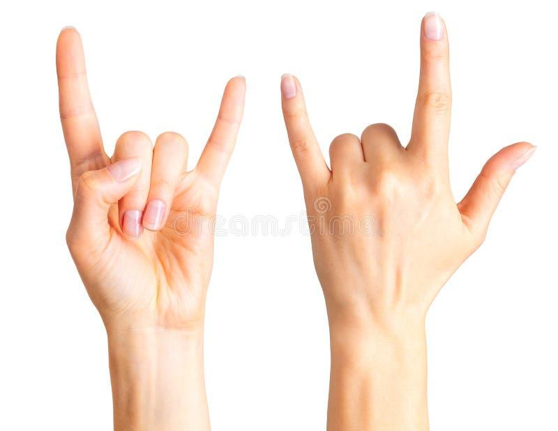 Placez des mains des femmes montrant le signe de petit pain de la roche n ou donnant au diable des klaxons geste photos stock
