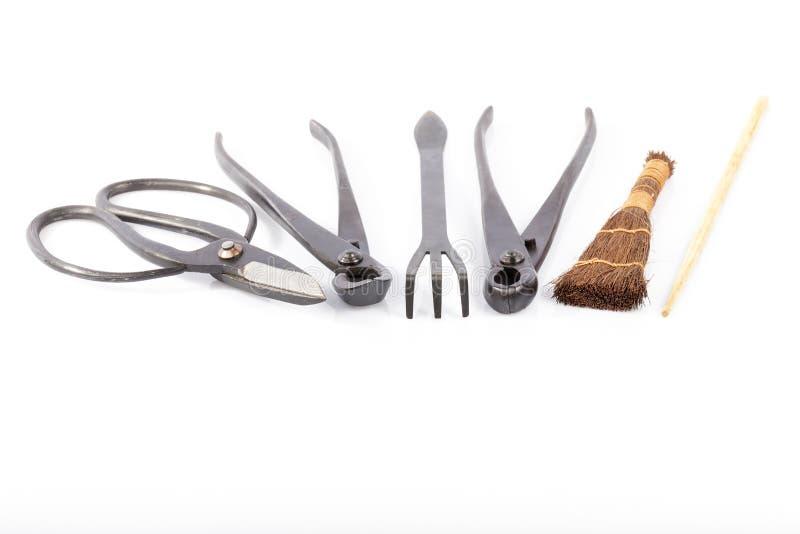 Placez des outils pour cultiver des bonsaïs d'isolement photographie stock