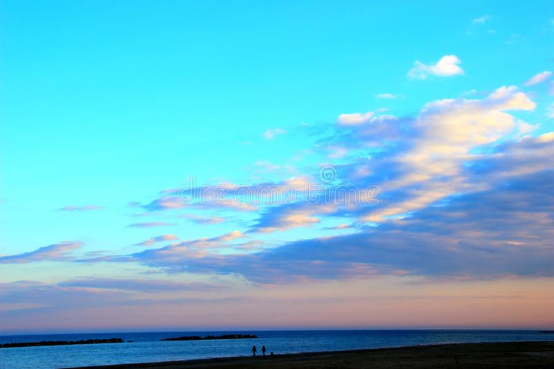 Placid sky with rising clouds over the sea stock photos