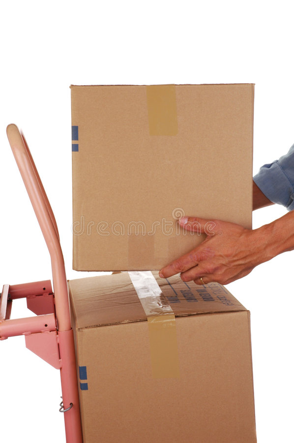 Placing Box on Hand Truck. Man Stacking a Moving Box on Hand Truck isolated on white stock photo