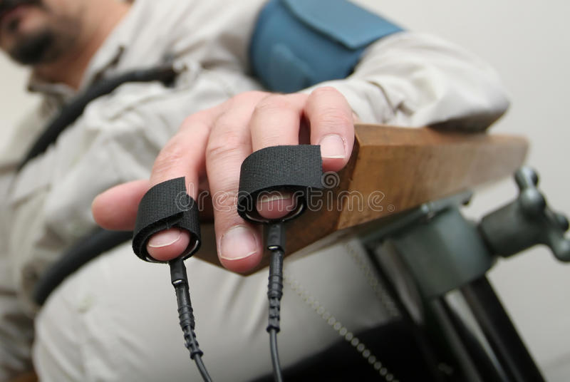 Placing equipment lie detector stock images